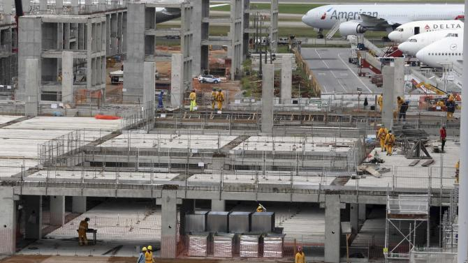 Labourers work on the expansion of the international airport in Guarulhos, near Sao Paulo