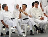 Singapore Deputy Prime Minister Wong Kan Seng takes a photo of minister for the environment Yaacob Ibrahim using a mobile phone at an election rally in Singapore on May 2011. Asia-Pacific is leading a surge in the use of mobile devices as they play a more central role in people's lives and are on track to replace conventional computers, a top Google executive said Wednesday