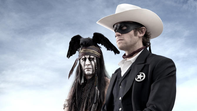 "This undated publicity photo from Disney/Bruckheimer Films, shows actors, Johnny Depp, left, as Tonto, a spirit warrior on a personal quest, who joins forces in a fight for justice with Armie Hammer, as John Reid, a lawman who has become a masked avenger in ""The Lone Ranger."" (AP Photo/Disney/Bruckheimer Films, Peter Mountain)"