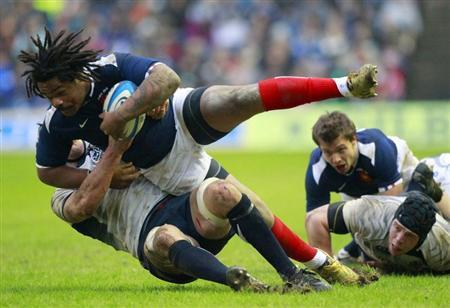 Scotland's Kelly Brown tackles France's Mathieu Bastareaud during their Six Nations rugby union match in Edinburgh, Scotland