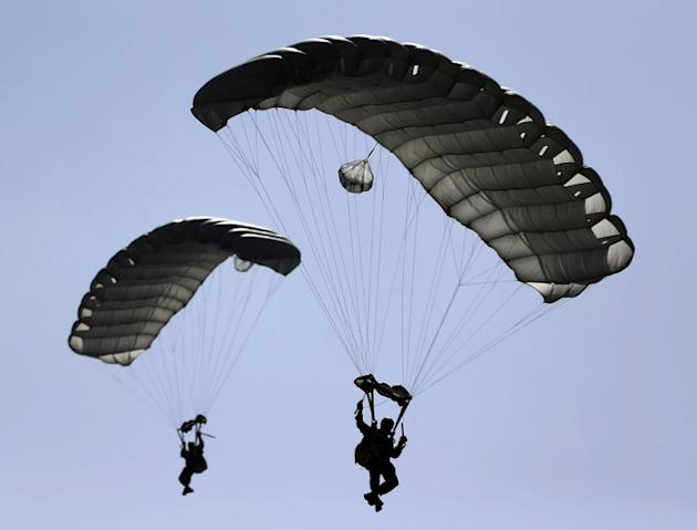 Members of the United Arab Emirates' armed forces perform during the opening ceremony of the International Defence Exhibition and Conference (IDEX) at the Abu Dhabi National Exhibition Centre in the E