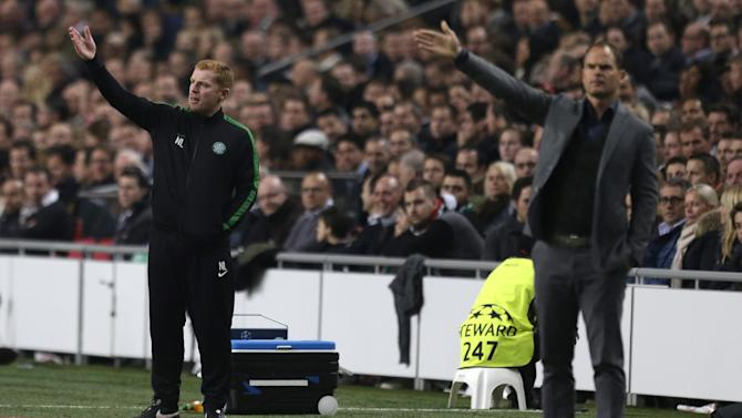 Celtic manager coach Neil Lennon, left, and Ajax's coach Frank de Boer, right, gesture during the Champions League Group H soccer match between Ajax Amsterdam and Celtic Glasgow at ArenA stadium in Amsterdam, Netherlands, Wednesday, Nov. 6, 2013