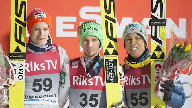 First placed Kranjec of Slovenia stands between second placed Gangnes of Norway and third placed Kasai of Japan after the FIS Ski Jumping World Cup Flying Hill competition in Vikersund