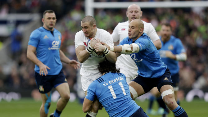 England's Mike Brown in action with Italy's Giovanbattista Venditti