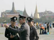Thai policemen stand guard in Bangkok in March 2007. Two English teachers, one American and the other British, have been found dead sitting side-by-side in the living room of an apartment on the outskirts of the Thai capital, police said