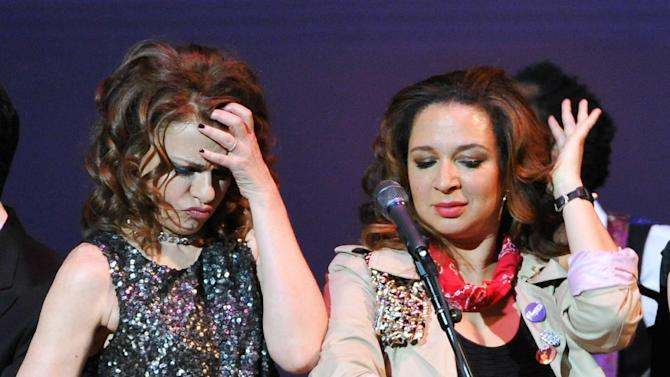 """Actors Sandra Bernhard, left, and Maya Rudolph perform together during the encore at """"The Music of Prince"""" tribute concert at Carnegie Hall on Thursday March 7, 2013 in New York. (Photo by Evan Agostini/Invision/AP)"""