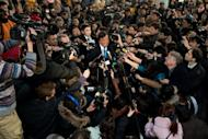 Former New Mexico governor Bill Richardson (centre) and Google chairman Eric Schmidt (centre left) talk to the media after arriving at Beijing airport from North Korea on January 10, 2013. Richardson said he did not meet a detained American whose case he had cited as part of the reason for the trip