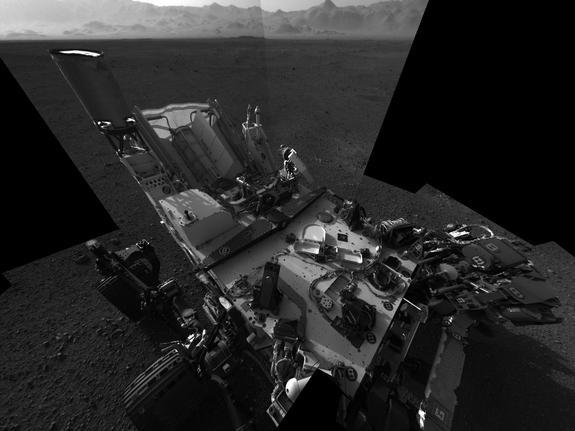 This high-res mosaic of 20 images is the first clear self-portrait of NASA's Mars rover Curiosity on the Red Planet. The rear of the rover is at top, with two right-side wheels on the left. The rim of Gale Crater forms the lighter-color strip o