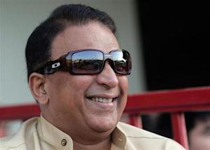 Former Indian cricketer Sunil Gavaskar smiles while watching a cricket match between teams featuring expatriate players from India and Pakistan at the Sharjah Cricket stadium March 25, 2008. REUTERS/Redgi Varghese/Files