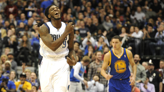 Dallas Mavericks small forward Jae Crowder (9) celebrates after a basket in the second half during an NBA basketball game against the Golden State Warriors, Wednesday, Nov. 27, 2013, in Dallas