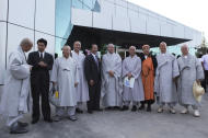 Sim Sang Jin from North Korea's Buddhist Association, center in suit, South Korean Buddhist Ri Kyong Sik, standing at Sim's right, and other South Korean Buddhists from the Jogye Sect pose for a photo outside Pyongyang airport in Pyongyang, North Korea, Saturday, Sept. 3, 2011. Due to political tensions, South Korean citizens are prohibited from traveling to North Korea without government permission. However, the religious delegation received approval in Seoul to make the rare trip to attend a ceremony at ancient Pohyon Temple in the mountains northwest of the North Korean capital. (AP Photos/APTN)