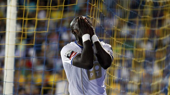 Porto's Eliaquim Mangala, from France, reacts after missing a chance during the Portuguese league soccer match between Estoril and Porto at the Antonio Coimbra da Mota stadium in Estoril, near Lisbon, Sunday, Sept. 22, 2013. The match ended in a 2-2 draw