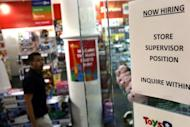 "A ""now hiring"" sign is viewed in the window of a toy store in New York City. The US Federal Reserve took aim at slow growth and high joblessness, announcing a new, open-ended $40 billion per month bond-buying program as it slashed its 2012 growth forecast"