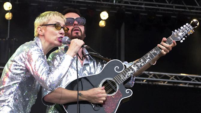 """File- This June 10, 2000, file photo shows Annie Lennox, left, and Dave Stewart as the Eurythmics performing on stage at the Rock at the Ring three-day music festival at the Nuerburgring race circuit in Nuerburg, Germany. The Eurythmics are reuniting to pay tribute to the Beatles. The Recording Academy announced Monday Jan. 6, 2014, that Lennox and Stewart will perform as a duo for """"The Night That Changed America: A Grammy Salute To The Beatles."""" The event will tape at the Los Angeles Convention Center on Jan. 27, a day after the Grammy Awards. (AP Photo/Pool)"""