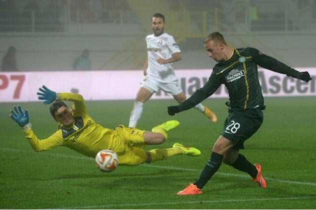 Leigh Griffiths (R) scored the first goal for Celtic after the champions were awarded a penalty four minutes into the match against Ross County, as the new season of the Scottish Premiership got under
