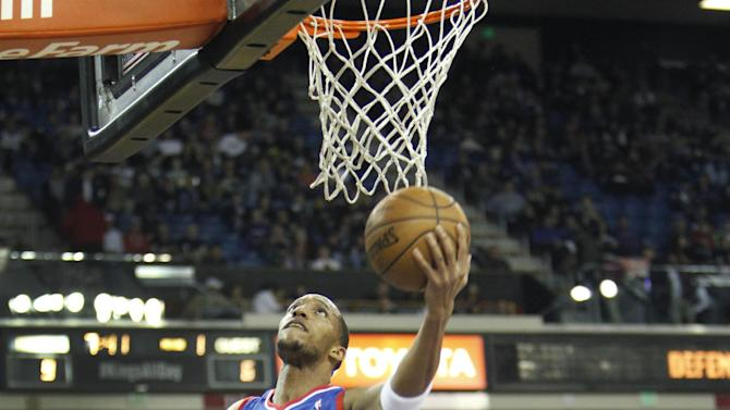 Philadelphia 76ers forward Evan Turner (12) drives to the basket against Sacramento Kings defender Rudy Gay (8) during the first half of an NBA basketball game in Sacramento, Calif., on Thursday, Jan. 2, 2014