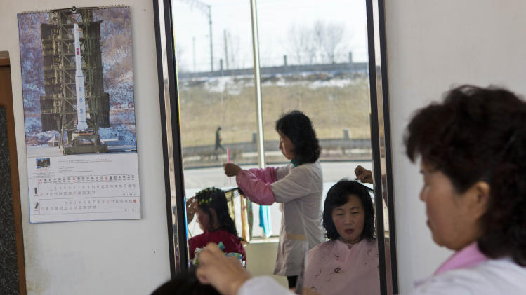 A 2013 calendar, showing a picture of North Korea's Unha-3 rocket, hangs inside a hair salon in Pyongyang, North Korea on Wednesday, Feb. 20, 2013. (AP Photo/David Guttenfelder)