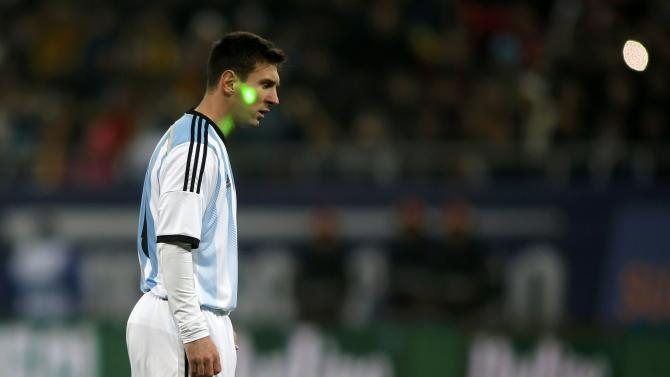 A fan uses a laser pointer on Argentina's Messi during their international friendly soccer match against Romania at the National Arena in Bucharest