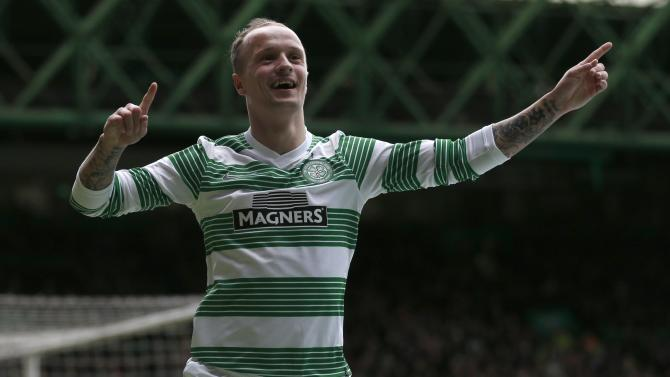 Celtic's Leigh Griffiths celebrates his goal against Inverness Caledonian Thistle during their Scottish Premier League soccer match at Celtic Park Stadium in Glasgow