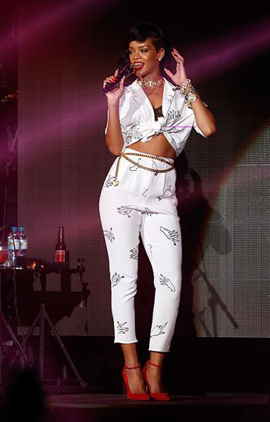 Day 5: Rihanna on stage in London (again) - The most feminine look of the week award goes to… this one! Our girl was gorgeous in a Happy Ashley printed top and pants, What Katie Did bra, custom Manolo