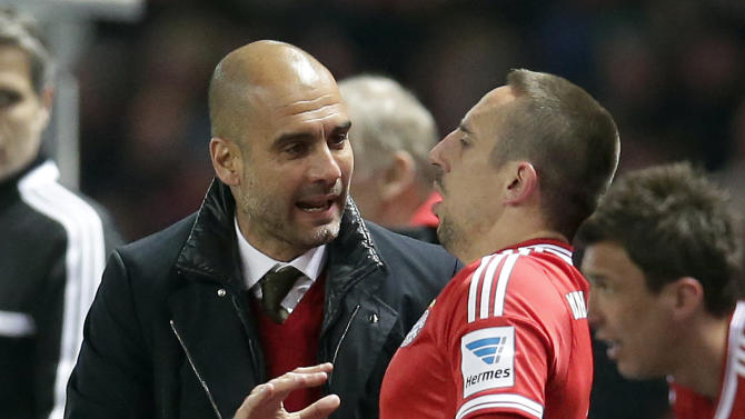 Bayern head coach Pep Guardiola of Spain, left, talks to player Franck Ribery of France, right, during the German Bundesliga soccer match between Hertha BSC Berlin and Bayern Munich in Berlin, Germany, Tuesday, March 25, 2014