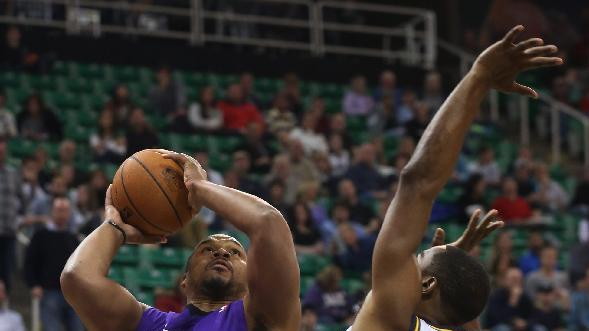 Sacramento Kings' Chuck Hayes (42) shoots as Utah Jazz's forward Mike Harris (33) defends in the first half of an NBA basketball game on Saturday, Dec. 7, 2013, in Salt Lake City