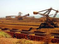 "This file photo shows remote-controlled stackers and reclaimers moving iron ore to rail cars at Rio Tinto's Port Dampier operations in Western Australia's Pilbara region. Trade unions said on Saturday they would call on the government to introduce a millionaires' tax similar to US President Barack Obama's so-called ""Buffett Rule."""