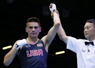 Jose Ramirez of the USA is awarded a 21-20 points victory over Rachid Azzedine of France during the London 2012 Olymipic Games on July 29. The United States men's boxing team was cleared on Wednesday by amateur boxing chiefs of allegations their fighters had signed contracts with professional promoters prior to the Olympic Games