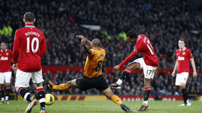 Manchester United's Nani, center right, scores against Wolverhampton Wanderers during their English Premier League soccer match at Old Trafford Stadium, Manchester, England, Saturday Dec. 10, 2011. (AP Photo/Jon Super)