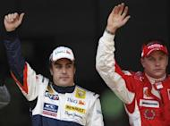 Formula One drivers Kimi Raikkonen of Finland (R) and Fernando Alonso of Spain celebrate after qualifying in pole and second position respectively for the Spanish F1 Grand Prix at the Catalunya racetrack in Montmelo, near Barcelona, April 26, 2008. REUTERS/Dani Cardona/Files