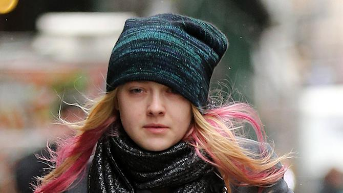Actress Dakota Fanning picks up a coffee at Balthazar on a snowy-day in SoHo, New York City