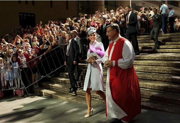 Britain's Catherine, Duchess of Cambridge, is escorted by Archbishop of Sydney Glenn Davies following an Easter Sunday Service in Sydney