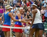 The Czech Republic's Andrea Hlavackova (left) and Lucie Hradecka shakes hands with Venus Williams (foreground) and Serena Williams after the Olympic women's doubles final