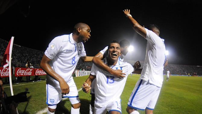 Honduras' Carlo Costly, center, celebrates with teammate Wilson Palacios, left, after scoring against Panama at a 2014 World Cup qualifier soccer match in Tegucigalpa, Honduras, Tuesday, Sept. 10, 2013