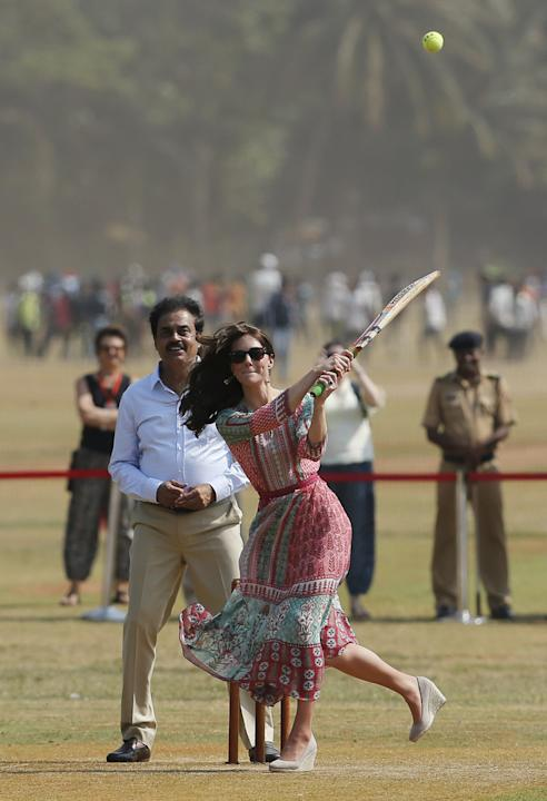 Britain's Catherine, Duchess of Cambridge, plays cricket with children at a ground in Mumbai, India