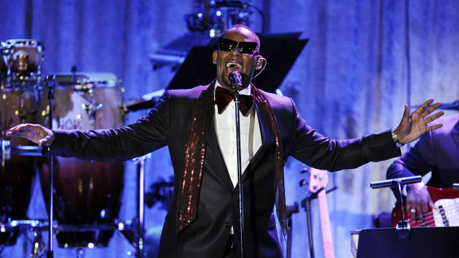 """FILE - In this Feb. 12, 2011, file photo, R. Kelly performs in Beverly Hills, Calif. Kelly announced on Monday, Nov. 19, 2012, that he's had an offer to bring """"Trapped in the Closet"""" to the stage, and he may even be in some performances. (AP Photo/Mark J. Terrill, File)"""
