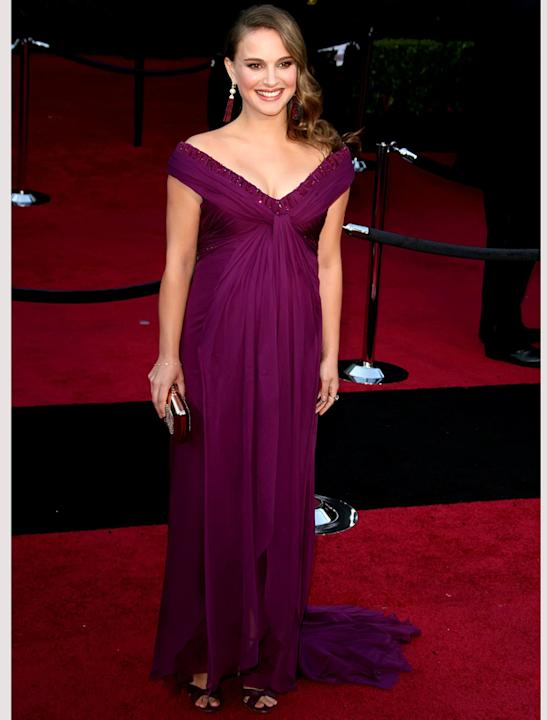 Oscars 2011 photos: A then pregnant Natalie Portman fashioned her bump with a Rodarte gown teamed with Jimmy Choo shoes.