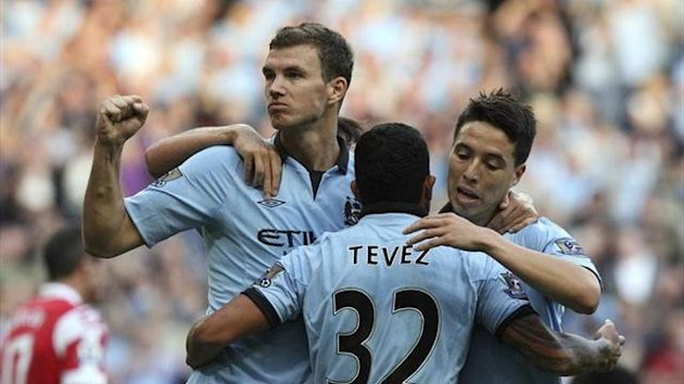 Dzeko, Tevez and Nasry celebrating a goal