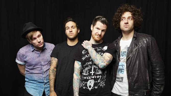 "This April 12, 2013 photo shows members of the band Fall Out Boy, from left, Patrick Stump, Pete Wentz, Andy Hurley and Joe Trohman in New York. Fall Out Boy's new album, ""Save Rock and Roll,"" released April 16, features Elton John on the title track. (Photo by Dan Hallman/Invision/AP)"