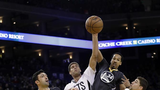 Golden State Warriors' Shaun Livingston (34) is defended by Brooklyn Nets' Brook Lopez (11) during the first half of an NBA basketball game Saturday, Feb. 25, 2017, in Oakland, Calif. (AP Photo/Marcio Jose Sanchez)