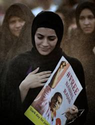 A Bahraini Shiite Muslim woman carries a portrait of Nabil Rajab, a human rights activist sentenced to three years in prison, during a rally in Shakhora on August 31. A Bahrain court on Tuesday upheld jail terms against 13 leading opposition figures, including seven facing life in prison, over charges of plotting to overthrow the Gulf monarchy, lawyers said