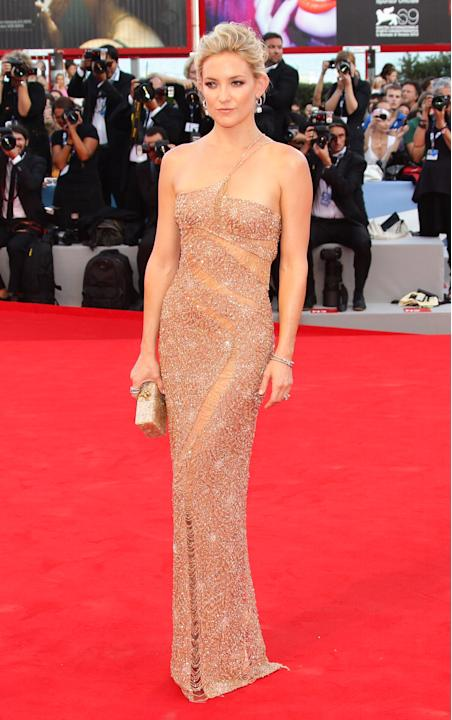 "Kate Hudson dazzled at the Venice Film Festival on August 29. The star attended the premiere of her new film, ""The Reluctant Fundamentalist,"" wearing  a one-strap, body-slimming nude gown by Atelier V"
