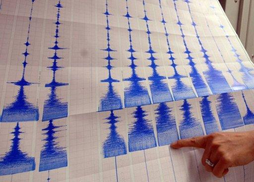 A seismologist points to a graphic showing an earthquake. Seismologists have unveiled a map highlighting zones most prone to unleashing the world's biggest earthquakes, including the 9.0 monster that struck northeastern Japan in March 2011.