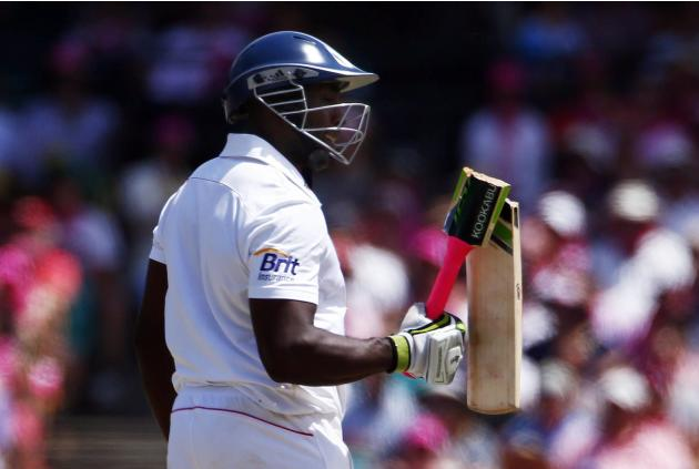England's Carberry reacts after his bat broke while trying to play a shot during the third day of the fifth Ashes cricket test against Australia at the Sydney cricket ground