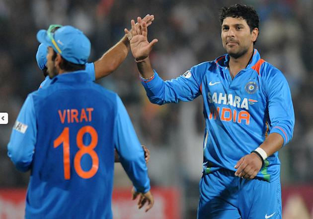 Yuvraj Singh celebrates after taking a wicket against England during the first T20 at the Subrata Roy Sahara stadium in Pune (c) BCCI