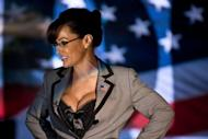 Lisa Ann, an adult film star and Sarah Palin tribute artist, speaks to members of the press at Thee DollHouse gentleman's club on August 25 in Tampa, Florida