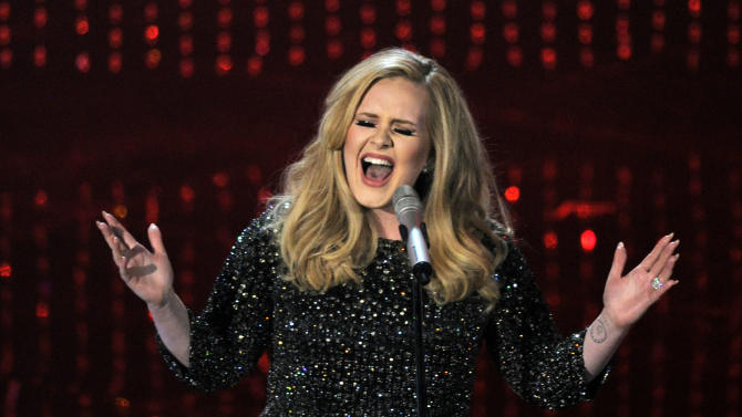 """FILE - This Feb. 24, 2013 file photo shows singer Adele performing """"Skyfall"""" during the Oscars at the Dolby Theatre in Los Angeles. There are hundreds of copycat versions of Adele's Oscar-winning song on the Spotify subscription service, confusing customers who think they are buying Adele's version. Adele's label, XL Recordings, is keeping her music off of streaming services until download sales peter out. In the meantime, copycat artists fill the void, racking up royalty revenue, often before customers realize they've been listening to someone else. (Photo by Chris Pizzello/Invision/AP, file)"""