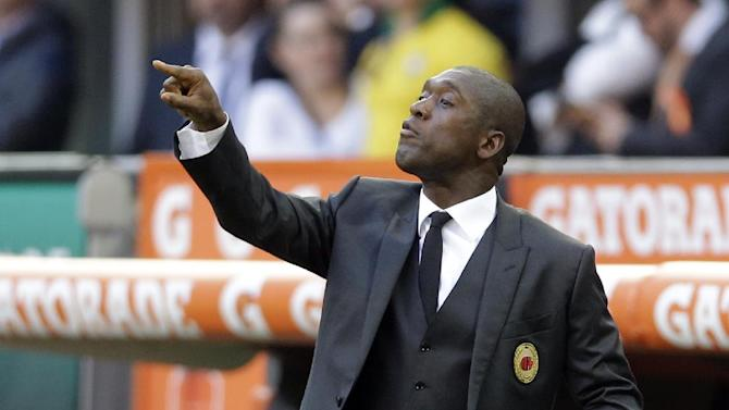 AC Milan coach Clarence Seedorf, of the Netherlands, gives indications to his players during a Serie A soccer match between AC Milan and Parma, at the San Siro stadium in Milan, Italy, Sunday, March 16, 2014
