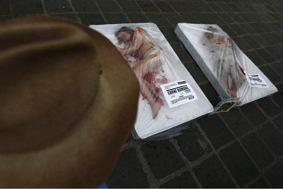 Animal rights activists protest against meat consumption through a performance to promote vegetarianism in Mexico City