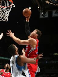 MINNEAPOLIS, MN - JANUARY 17: Blake Griffin #32 of the Los Angeles Clippers goes up for the easy bucket against Derrick Williams #7 of the Minnesota Timberwolves during the game on January 17, 2013 at Target Center in Minneapolis, Minnesota. (Photo by David Sherman/NBAE via Getty Images)